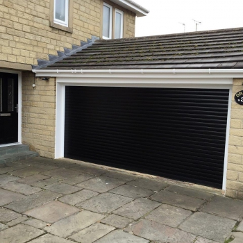 Black roller door with white pvc liners