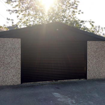 Black roller door with new concrete sides and pvc facia