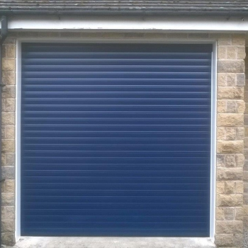 Blue roller door with white pvc liners