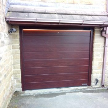 Hormann LPU40 M Ribbed DecoGrain in Rosewood complete with Operator and LED Strip Lights controllable from Garage Door Remote