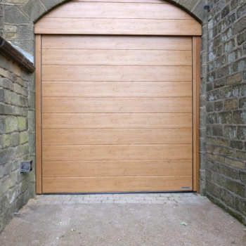 Hormann LPU40 M Ribbed DecoGrain in Winchester Oak with Sectional Cladding Archway